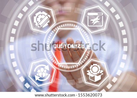 Businessman uses virtual touchscreen and touches word: customize. Customization product business concept. ストックフォト ©
