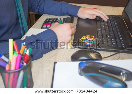 Businessman using a calculator to calculate the numbers. Businessman calculate finance and thinking about problem in home office. business male hands in office #781404424