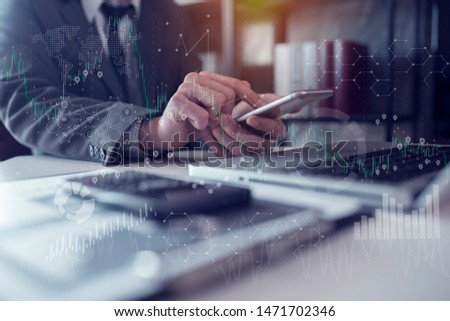 Businessman using a calculator with laptop and tablet on digital interface. innovation, icon and media information on network connection, Multi exposure, Concept of hight technology theme hologram. #1471702346