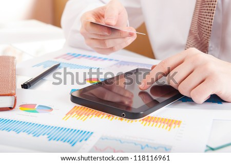 Businessman using a credit card and digital tablet for buying on-line