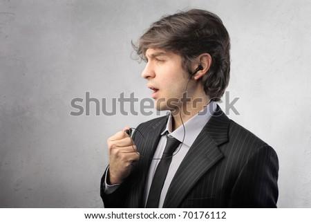 Businessman using a hands-free headset