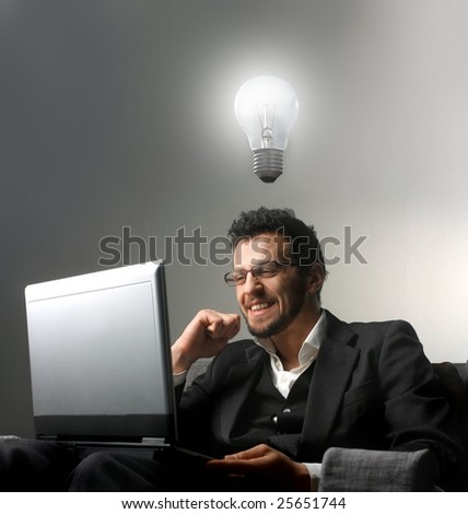 businessman using a laptop and having an idea