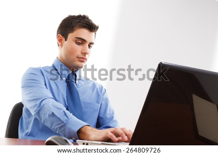 Businessman using a laptop computer on his desk