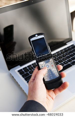 businessman using a mobile phone and laptop