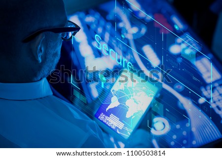 Businessman using advanced technology on a tablet