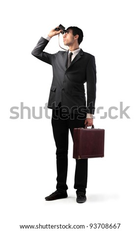Businessman using binoculars - stock photo