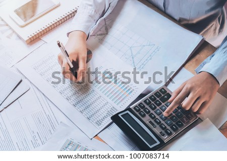 businessman using calculator for calculate budget. concept finance and accounting