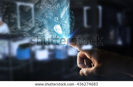 Businessman using digital graph interface with his hand #436274683