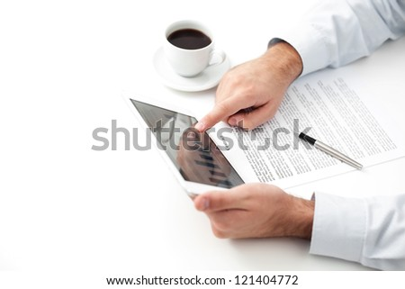 Businessman using digital tablet by the desk