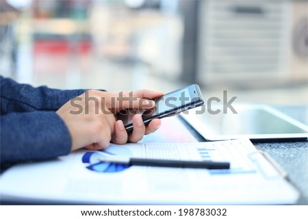 Businessman using digital tablet computer with modern mobile phone #198783032