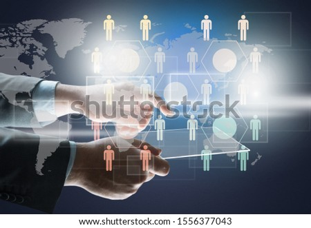 Businessman using digital tablet with global business infographics hologram. Concept of hi tech and future technology in business analysis. Toned image          - Image