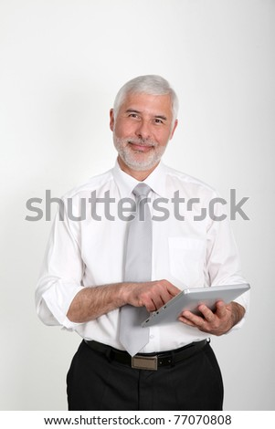 Businessman using electronic tablet - stock photo