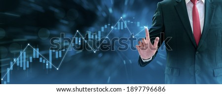 Businessman using finger touch symbol stock graph and chart background,concept growth and development business investment,Stock market and strategy making market plan and stock market fluctuations