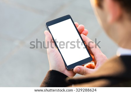 Businessman using his Mobile Phone outdoor, close up #329288624
