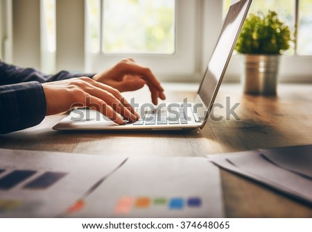 businessman using laptop computer sitting working office. #374648065