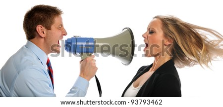 Businessman using megaphone to scream at woman isolated over white background