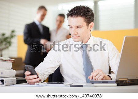 Businessman using mobile phone in an office