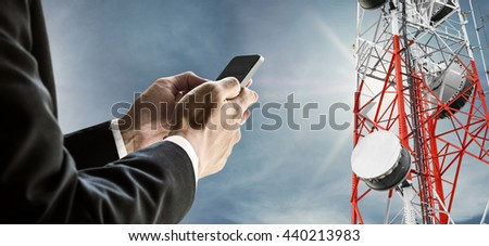 Businessman using mobile phone, with satellite dish telecom network on telecommunication tower on blue sky with sunshine