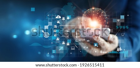Businessman using mobile smartphone on global network connection on investor and customer with sale data exchange and development of business. Technology and digital marketing. Financial and banking.
