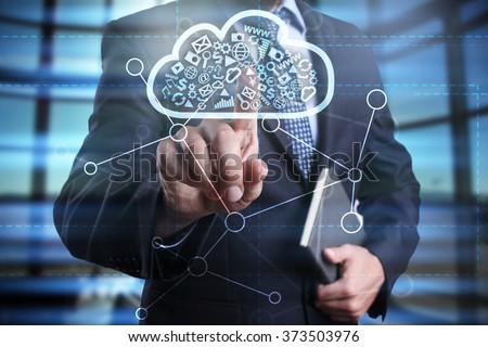 businessman using modern computer, pressing button on virtual screen. cloud technology and networking concept.  #373503976