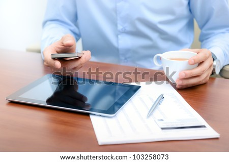 Businessman using new technologies for success workflow.