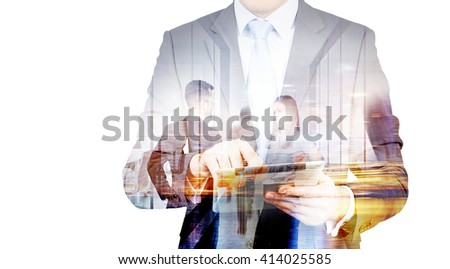 Businessman using pad with people shaking hands in the background. Double exposure