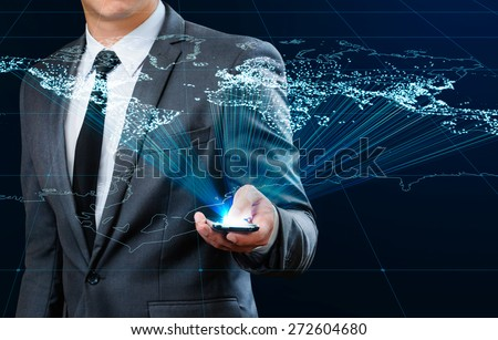 businessman using smart phone making global connection