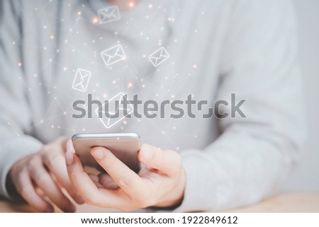 Businessman using smartphone with e-mail icon , technology concept. Photo stock ©