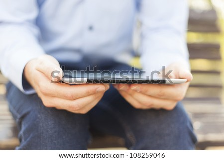 Businessman Using Tablet Computer in park