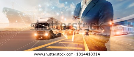 Businessman using tablet on logistic network distribution and smart transportation and networking intelligent logistics of truck and train container cargo ship, Logistic import export and industry.