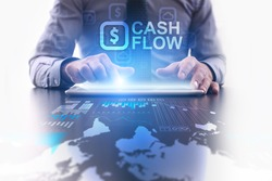 Businessman using tablet pc and select Cash flow.