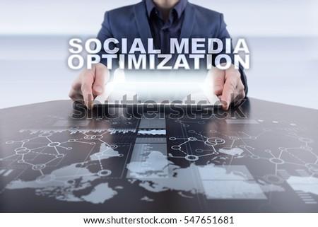 Businessman using tablet pc and selecting social media optimization.