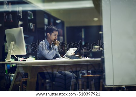 businessman using tablet pc in meeting room