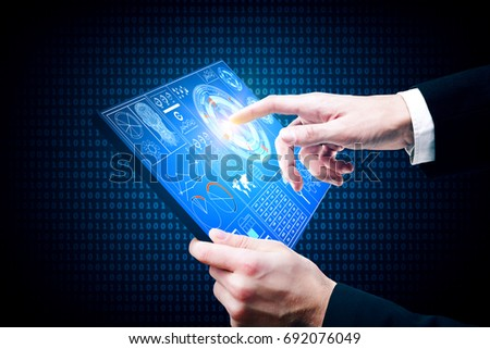 Businessman using tablet with business chart on screen. Future and technology concept  #692076049