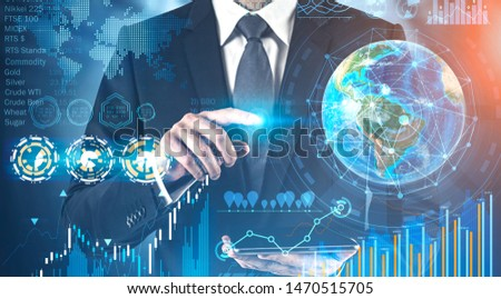 Businessman using tablet with double exposure of global business infographics HUD interface. Market analysis concept. Toned image. Elements of this image furnished by NASA #1470515705