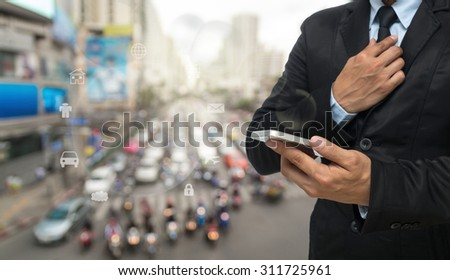 Businessman using the smart phone on abstract Blurred photo of traffic jam with rush hour #311725961