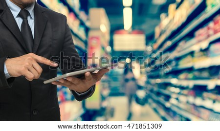 Businessman using the tablet on Abstract blurred photo of store in department store bokeh background, business shopping concept #471851309