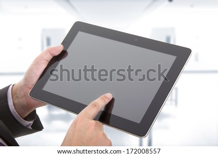 businessman using touch pad, close up shot
