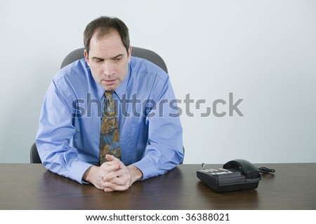 Businessman waiting for a phone to ring