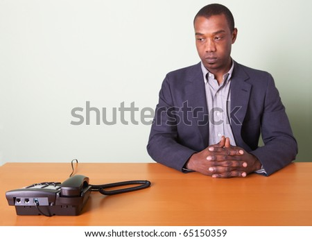 Businessman waiting for telephone to ring