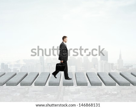 businessman walking and city on background