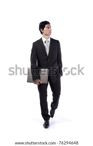 Businessman walking and looking up (isolated on white) - stock photo