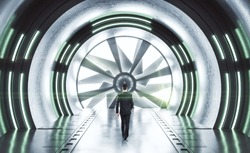 Businessman walking in futuristic space ship interior with neon light. Abstract tunnel.  Future and design concept.