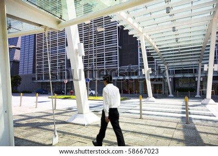 Businessman walking in modern building outdoor