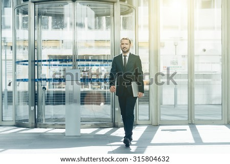Businessman walking in the hall entrance