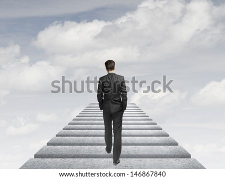 businessman walking in the sky