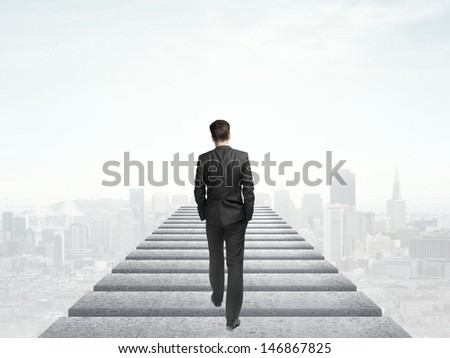 businessman walking in the sky and city