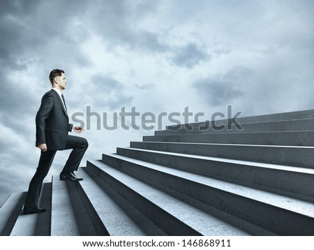 businessman walking near ladder in sky