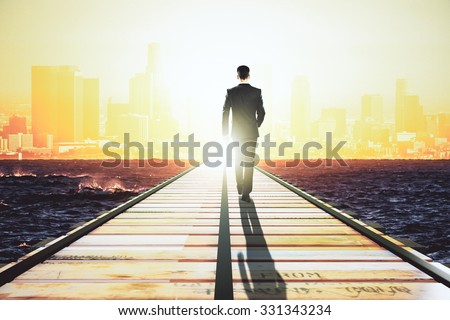 businessman walking on a...