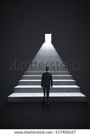 businessman walking on steps to door